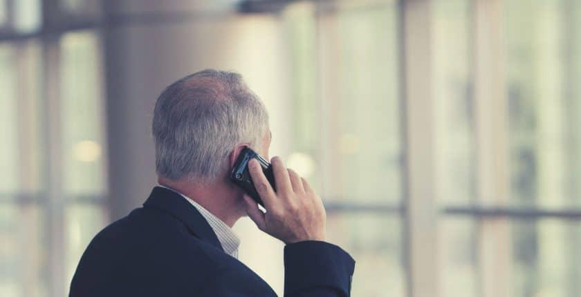 mature man on mobile phone