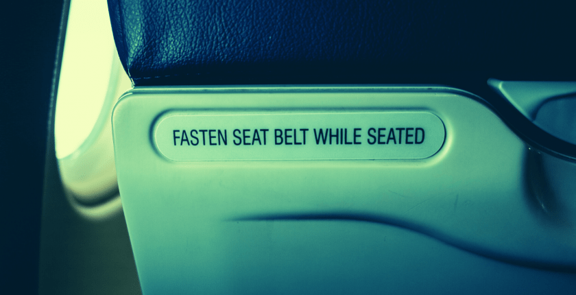Fasten seatbelts while seated on back of airline seat
